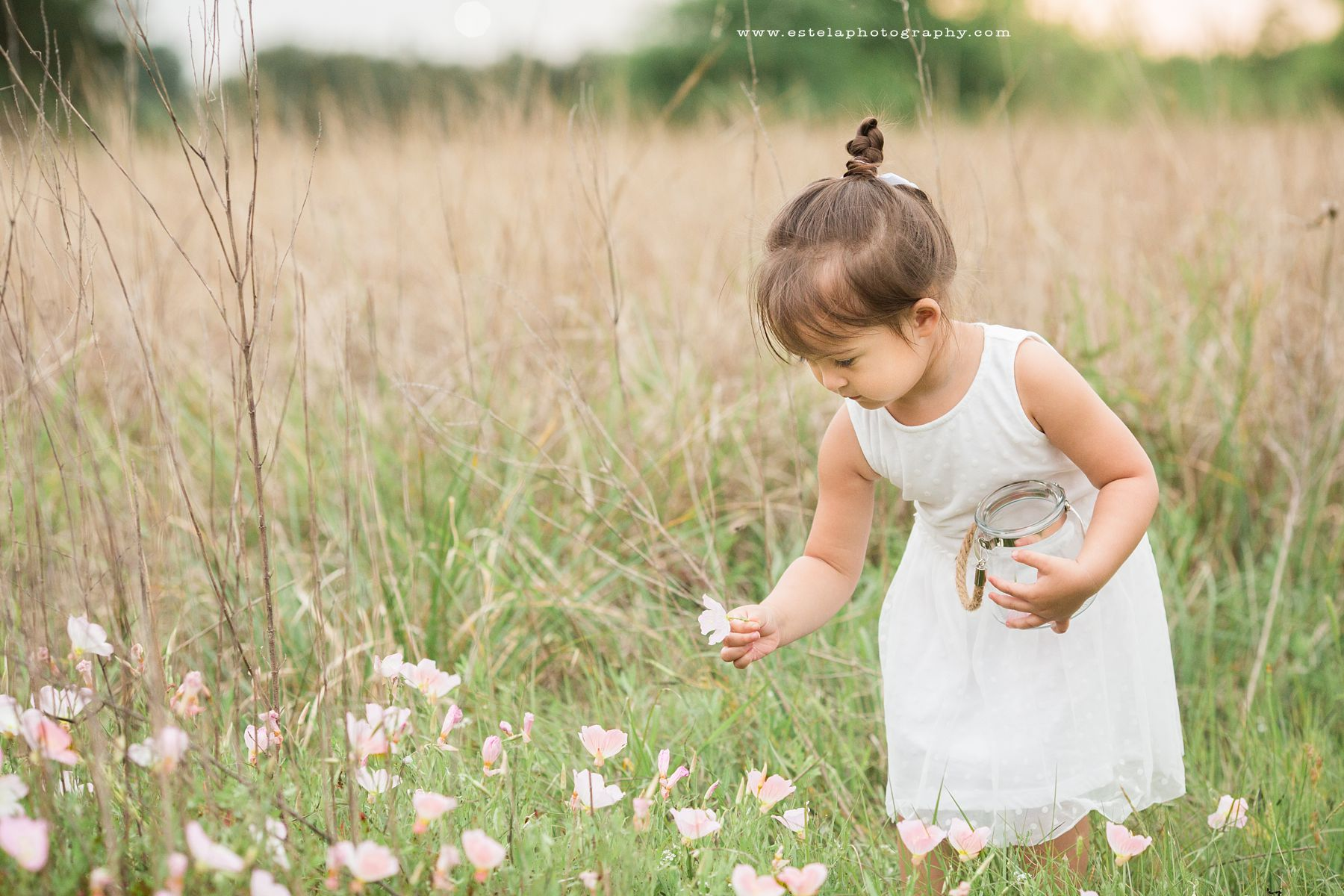 picture of girl picking flowers