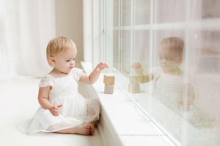 Reflection of Baby on Window Photography
